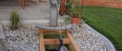 Brunnen mit Holz und Edelstahl